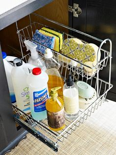 12. Close At Hand Cleaners.  Sanitation and cleanup are key in any kitchen space so install a rack inside your sink cabinet to house your daily cleaning essentials.