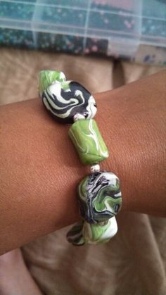 Hand made polymer clay.. green white n black