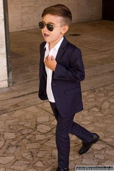 29f54f80e Little boy looking so confident in his suit.