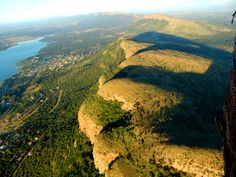 View of the Magaliesburg mountains with Hartbeespoort dam on the left - South Africa. places in south africa North West Province, South Afrika, Port Elizabeth, Holiday Places, Pretoria, Adventure Is Out There, Africa Travel, Scenery, Places To Visit