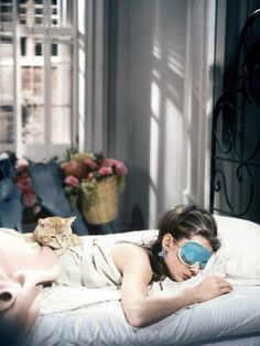 Audrey Hepburn in Breakfast at Tiffany's My roommates and I are trying to decide what to name the cat. We could always just pull an Audrey Hepburn and not name it.