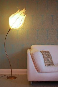 An elegant floor lamp with a  flower head.