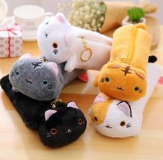 Cute Plushy Cat Pencil Case - Two Stupid Cats You can now relax in the office or school and pet your plushy Kitty pencil case-maybe she'll Purrr or offer you a pencil :).  Size:23*8 cm Material: Plush Closure type: Zipper