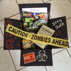 We love the walking dead! A zombie theme deployment care package! I added snacks, zombie nerf gun, max brooks zombie survival guide and zombie playing cards!