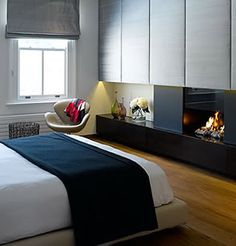 bedroom w/ a fireplace