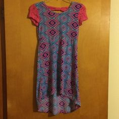 Cute girlie dress!! Jr girlie dress, short in the front and longer in the back with a bow, size 10/12, excellent condition, no holes or tears, perfect for summer!! Dresses