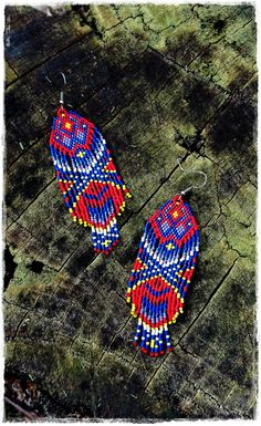 Amazing Native American inspired earrings, full of Primal Energy. ✨ With vivid, rich colours combined in this unique pattern, these earrings represent Power and deep Self-esteem, as you can feel a powerful connection with the Goddess within you...✨ To make the earrings I used over 1600 seed beads, woven one by one, in 7 different colours: Coral, Cobalt, Lavender, Yellow, White, Cobalt with rainbow touch and Chocolate. You can be sure that this piece is infused with a lot of love and…