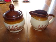 The sugar bowl would have a scratched off or painted design. But it'll look very sturdy with a lid that rests on top.