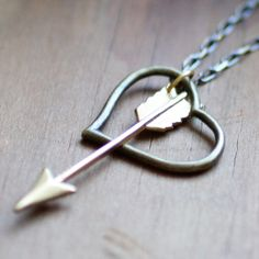 Two pendants in one, the Shot through the Heart Necklace is a new take on a classic concept. The arrow swings free, designed to constantly move, but always limited to the empty space left in the brass heart outline. Poetic, ain't it?