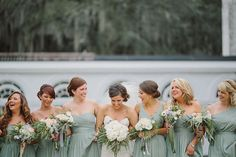 "Bridesmaids in a variety of chiffon J.Crew dresses in ""Dusty Shale."""
