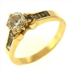 4.6 Gram 14kt Yellow Gold Ring With Colorless Stones  http://www.propertyroom.com/l/46-gram-14kt-yellow-gold-ring-with-colorless-stones/9445856