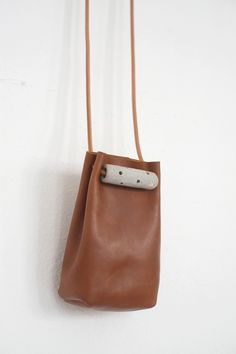 butterscotch brown leather (unlined) with stoneware details and leather cord straps16cm H x 9cm W x 5cm D