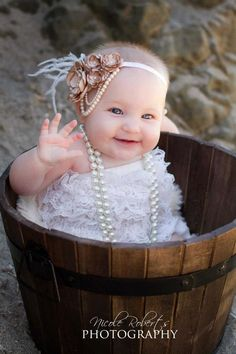 @Nora Helman - Belle Bedell  1920s Style Champagne Flower Headband/Baby Headband/Photo Prop/ Flower Girl Headband. $17.80, via Etsy.