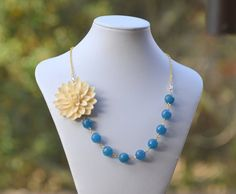Chunky Asymmetrical Asymmetrical Statement Necklace with Large Ivory Flower and Dark Cyan Blue Jade Beads in Gold.  Fall Fashion.