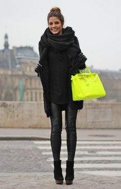 Black is definitely the new black . . . and even better with a shot of acid green, great style, and doesn't look studied. But are those heels really high or is she standing on her toes?