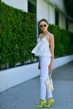 Shop this look on Lookastic:  https://lookastic.com/women/looks/white-peplum-top-white-skinny-jeans-green-yellow-pumps-white-clutch/2299  — White Skinny Jeans  — Green-Yellow Leather Pumps  — White Leather Clutch  — White Peplum Top