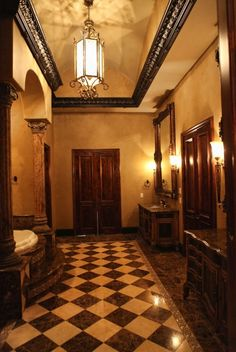 harry potter-ish. a little mc-mansion faux rustic though. get rid of checkered floor. use same marbled pattern of dark brown polished concrete.