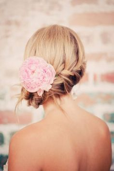 Braided Side Bun for bridesmaids ... Love it! .. except to the right and with a white or red flower