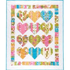 """Just in time for Valentine's Day, this 56"""" x 68"""" quilt is quick and easy to make with precut strips.  Supply list for Heartstrings Pattern - Heartstrings by black Mountain Quilts. Jelly roll of your choice.   Background - 2-5/8 yd. Binding - 5/8 yd. Backing - 4-1/2 yd. Batting - 60""""x72"""" piece."""