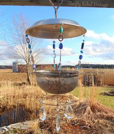 Make a sieve bird feeder using a repurposed sieve/strainer and a few other repurposed items.