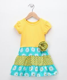 HippoHula Teal Daisy Bella Dress    So it looks like this is a purchased t-shirt with a few layers of ruffles sewn to the waist, nice!
