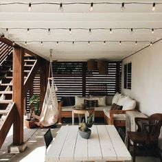 relaxed patio with bistro lights.