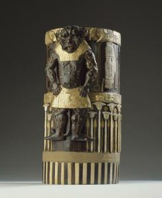 Box of cedar wood with ebony veneers and ivory inlays and gilding depicting the god Bes and bearing the cartouches of Amenhotep II: Ancient Egyptian, New Kingdom, 18th Dynasty, c.1550-1295 BC