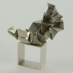 Ring   Rose Warner. Sterling silver, photo-etched and hand folded
