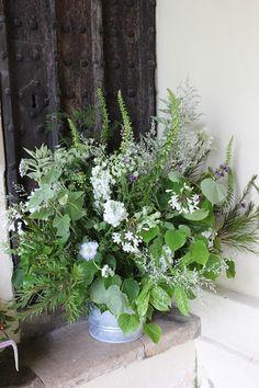 church porch bucket of flowers
