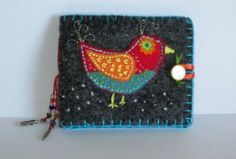 Embroidered applique needle book by Chuckiegirl on Craftster.org