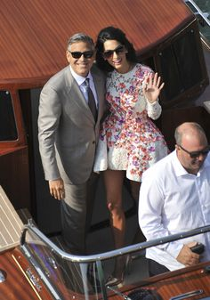 George Clooney and his wife, Amal Alamuddin, cruise the Grand Canal on Sunday in Venice, Italy. Description from jsonline.com. I searched for this on bing.com/images
