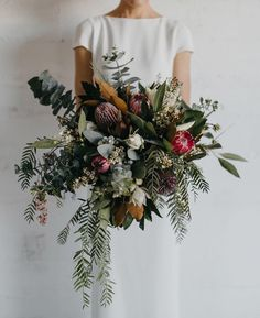 """Nouba on Instagram: """"Oversized, untamed and packed with gorgeous natives - this incredible bouquet by @_thesecretgardenn_ is everything we love in a bouquet. If you missed Chris & Anneke's modern Townsville wedding, be sure to get your floral fix over on the homepage. @sbcreativeco_"""""""