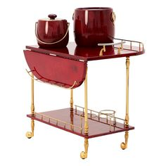 Very Complete Bar Cart By Aldo Tura - With Several Accessories  Italy  1950's  Superb liquor trolley/bar cart made by Aldo Tura.   Very nice produced drink trolley with two leaves that can folded up to extend the top surface.    The red lacquered goatskin is very warm of tint and makes a wonderfull combination with the brass details.