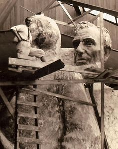 Luigi Del Bianco in Gutzon Borglum's studio at Mount Rushmore with the models for George Washington and Abraham Lincoln.