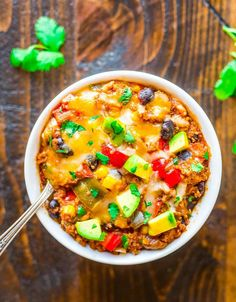 Super easy and DELICIOUS Crock Pot Mexican Casserole with quinoa, black beans, and ground chicken or turkey. Healthy, gluten free comfort food!
