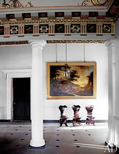 Dumfries House - A painting by Jacob de Heusch is displayed in the entrance hall, and the trio of hall chairs is from a set of eight by Alexander Peter. The frieze alternates Order of the Thistle stars with the mythical wyvern, a Crichton family crest.
