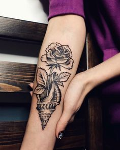 16 Stunning Tattoos by Sasha Kiseleva I know that this is kinda a odd pairing for a tattoo...but for some reason I am in love with the seashell and rose together