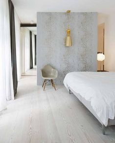 an old Berlin factory becomes a modern city home-modern take on wood floors-wide plank but with whitewash finish that works so well with the concrete wall, grey white, greige then the brass light fixture-so many layers to this room Home Bedroom, Master Bedroom, Bedroom Decor, Gray Bedroom, Bedroom Ideas, Bedroom Wall, Light Bedroom, Clean Bedroom, Bedroom Interiors