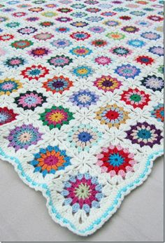 Flowers in the Snow crochet afghan. Circle in a square. Also called Older Sister afghan.