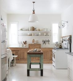 Vintage-inspired farmhouse kitchen with a mix of old + new from Vintage Whites Blog.