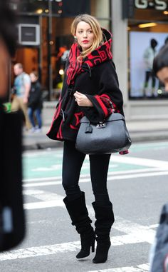 Blake Lively covers her baby bump in a red-and-black Lindsey Thornburg number. (Click for details on her latest look!)