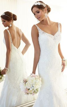 Beading and lace make the perfect wedding dress combo! Dress via Olivelli