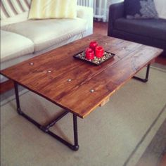 Reclaimed wood table with Iron Pipe Legs