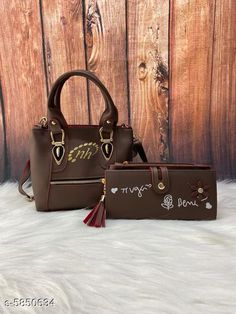 Handbags Elite Fancy Women Handbags & Wallet  Material: PU No. of Compartments: 1 Pattern: Printed Multipack: 1 Sizes:Free Size (Length Size: 8 in Width Size: 3 in Height Size: 7 in) Country of Origin: India Sizes Available: Free Size   Catalog Rating: ★3.9 (624)  Catalog Name: Elite Fancy Women Handbags & Wallet CatalogID_882525 C73-SC1073 Code: 044-5850634-5301