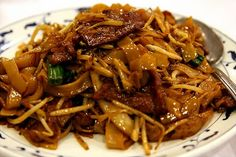 I went to Malaysia last year and had an amazing noodle dish - I think I have found a recipe that is about right: Beef Kway Teow Recipe