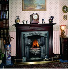 The raised grate of this fireplace is ideal for floral displays during ...
