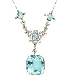 An early 20th century aquamarine and diamond necklace  The front composed of three delicate quatrefoil clusters, millegrain-set throughout with cushion-shaped and oval-cut aquamarines and old brilliant and single-cut diamonds, connected by similarly set single-cut diamond foliate swags, suspending a large cushion-shaped aquamarine pendant, mounted in platinum and yellow gold, on a fine trace-link chain, lengths: pendant 3.3cm, necklace 42.7cm
