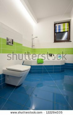 Travertine house - colorful bathroom: green, blue and white tiles by Kasia Bialasiewicz, via ShutterStock