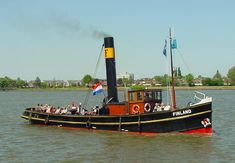 Another example of a Dutch steam tug.  I rode this boat from Rotterdam to Dordrect in 2000.  Amazing how little room there is below; these are all business.  The funnel tips on these; you can see the large circular black counterweights.