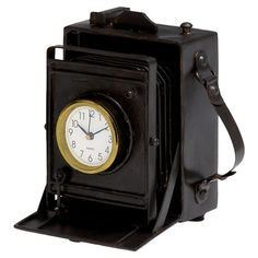 Table clock with a vintage-style camera silhouette.  Product: Table clockConstruction Material: Iron, glass and ...